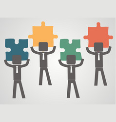 team concept - people pick up puzzles vector image