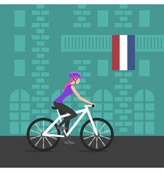 Cyclist girl on bike that rides through the city vector