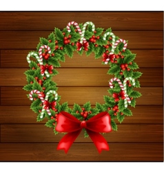 Christmas holly wreath in wood background vector