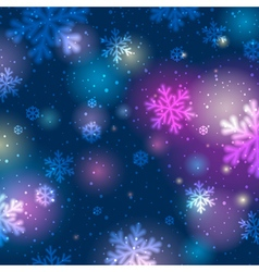 Blue background with bokeh and blurred snowflakes vector