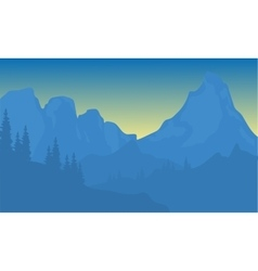 Silhouette of mountain with blue background vector