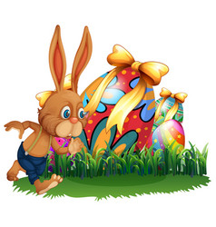 Brown bunny and easter eggs vector