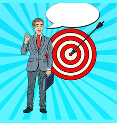 Pop art happy businessman achieved the target vector