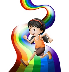 A rainbow with a young woman running vector image