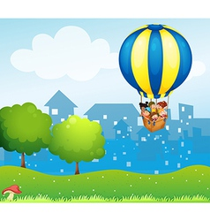 A big hot air balloon with kids vector image