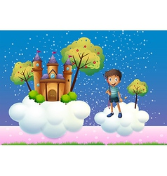 A boy and a floating castle vector