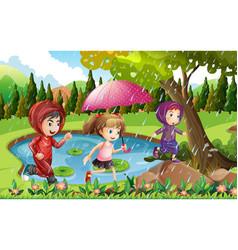 three kids running in the rain vector image