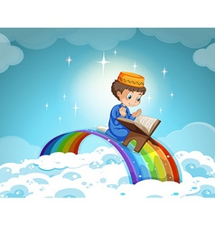Muslim boy praying over the rainbow vector image