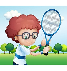A young boy playing tennis vector