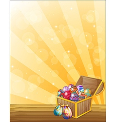 A treasure chest full of colorful eggs vector