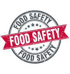 Food safety round grunge ribbon stamp vector