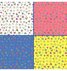 Four seamless patterns with colorful triangles vector