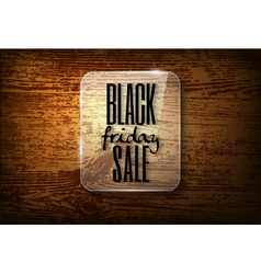 Black friday announcement in glass frame on wooden vector