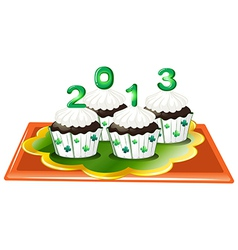 Four chocolate cupcakes for 2013 vector image