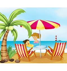 A mother and her child at the beach vector image vector image