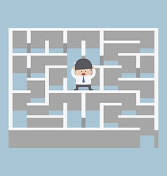 Businessman standing in center of the maze vector image