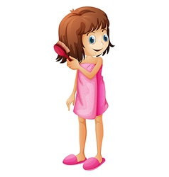 A young girl combing her hair vector image