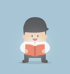 Businessman reading the shining book vector image vector image