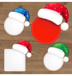 Wooden background with santa claus caps vector