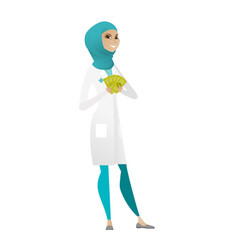 Happy muslim doctor holding money vector