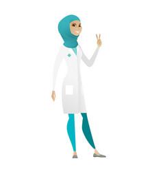 Muslim doctor showing victory gesture vector
