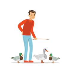 Farmer man feeding ducks poultry breeding vector