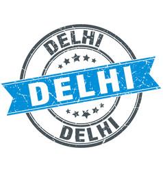 delhi blue round grunge vintage ribbon stamp vector image vector image