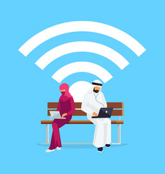 young muslim couple sitting on the bench vector image vector image