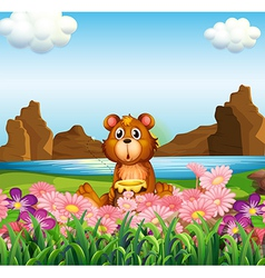 A cute bear near the flowers at the riverbank vector