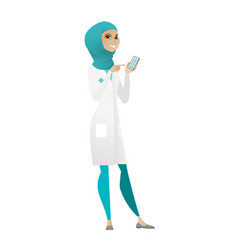 Muslim doctor holding a mobile phone vector