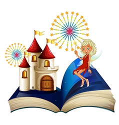 A storybook with a castle and a fairy vector