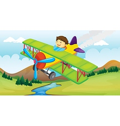 A boy and a flying airplane vector