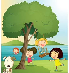 girls playing under tree vector image vector image