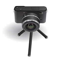 Digital photo camera on small tripod vector