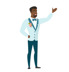 African-american groom showing a direction vector