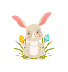cute cartoon bunny sitting on the grass holding vector image