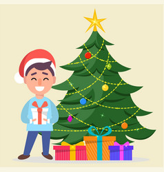 boy in santa claus hat standing near decorated vector image vector image