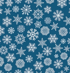 Blue seamless christmas background of flakes vector