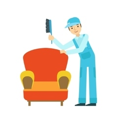 Man dusting armchair with brush cleaning service vector