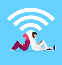 young muslim couple read using a tablet pc vector image vector image