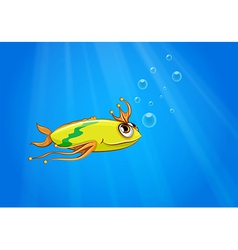 A yellow fish swimming under the sea vector