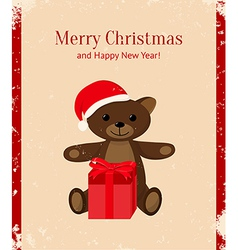Retro Christmas card with teddy bear and present vector image vector image