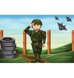 A soldier in front of the barbwire fence vector