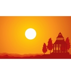 Silhouette of pavilion on the sunset vector
