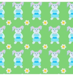 Seamless pattern of rabbits and flowers vector
