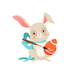 cute cartoon bunny with blue bow with egg funny vector image
