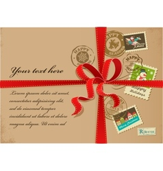 Christmas gift with red ribbon and vintage postage vector image
