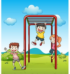 Kids playing monkeybar vector image
