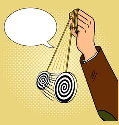 hand of hypnotist with pendulum pop art vector image