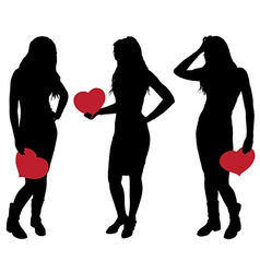 Silhouette of a girl holding a heart vector